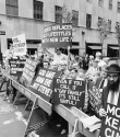 Anti-gay protestors hold signs across from St. Patrick's Cathedral in New York as the Gay Pride Parade passed by. 1984.